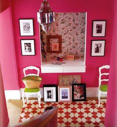 Pink Walls with white and gold frames in entry way