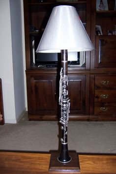 Normandy wood clarinet lamp. via Etsy.
