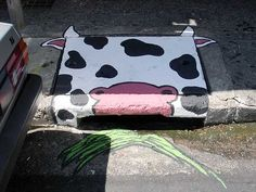 Grazing Cow Storm Drain - photo by SAO!, via Flickr