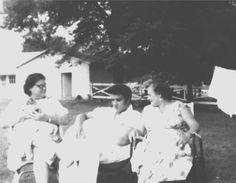 Left to right: Gladys Presley holding Sweet Pea, Elvis Presley and Catherine Adamshock. Memphis, Graceland, c.1957.