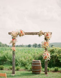 Add a little orange to your big day with this Fall floral arbor!