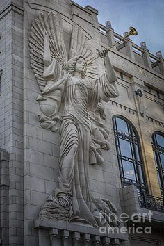 The angels that grace the exterior of the Bass Hall in Fort Worth, TX have become icons of the city. There are two angels, one on each end of the front facade of the building. Each is 48 feet tall, and sculpted by Marton Varo using Texas Limestone.