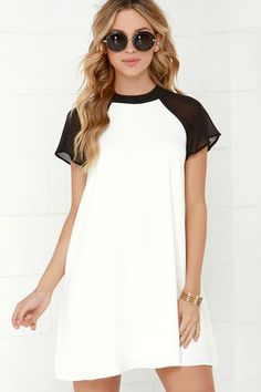 The In the Ballpark Black and Ivory Swing Dress is no less than a style home-run! Woven ivory fabric with a lengthy back keyhole swings down from a black rounded neckline with button closure, framed by short raglan sleeves composed of sheer black chiffon. Look Casual, Casual Chic, Sheer Dress, Chiffon Dress, White Chiffon, Sheer Chiffon, Ivory Dresses, Cute Dresses, Online Dress Shopping