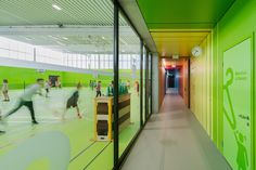 Swiss architecture studio Evolution Design have unveiled their latest completed project: a village sports centre whose interiors are almost completely covered in vibrant primary colours. Architecture Design, Contemporary Architecture, School Architecture, School Sports, Kids Sports, Evolution Design, Hall Colour, Colour Pop, Sport Hall