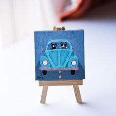 Teal Mini VW    -Painted with Golden acrylics.  -3 x 3 Mini Wrapped canvas  -Topped with two coats of gloss varnish.  -Signed, titled, and dated on the back by me!    A fun little tael Volkswagen bug painting, with cats of course! Comes with its own little wooden easel.    --------------------------------------------------------    The sides of the painting are painted black.    --------------------------------------------------------    I ship via USPS First Class Mail.    Please contact me…