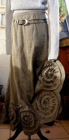 Wonderful swirling detail on each gore of this skirt.
