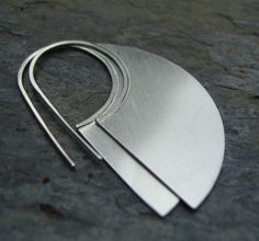 "Sterling Silver Machete Hook Earring: Created from 2"" discs with the ear wire detail carried all the way through. $80."