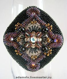 Krisitina Adams is beadwork artist from Latvia. She makes amazing unusual bead embroidered brooches.