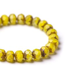 Semi-opaque yellow fire polished glass spacer picasso beads, 6х9 mm