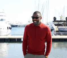 Idris Elba grinned in Cannes, France for a photocall event for new documentary Mandela, My Dad and Me on April 14.