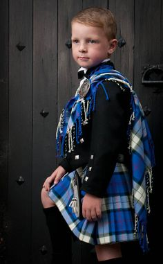 The sweetness of a boy dressed in a formal kilt and fly plaid.