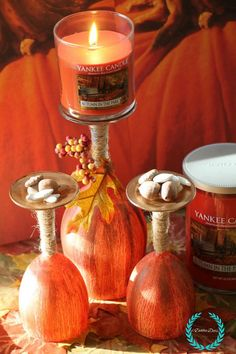 Diy pumpkin glasses and candle holders. An easy and fun craft you can do with a girls night get together to get you in the mood for Fall. The smell of Autumn is in the air. Lots of other fall decor craft ideas too.