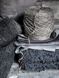 Natural fabrics, time worn, French grey with an indigo hue and natural linen colours