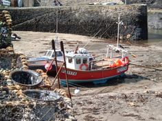 Boscastle harbour fishing boats & lobster pots.