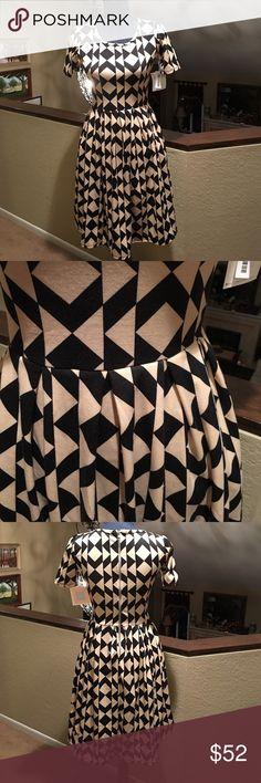 "LulaRoe Amelia LulaRoe Amelia Dress. Size XS. Cute Black and Tan design. Measures 16"" across bust. Length 37"". NWT. ❌No Trades❌Proceeds go towards feeding the homeless❗️ LuLaRoe Dresses Mini"