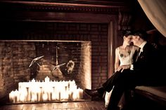 One of our Snug Harbor couples cozy up by the fireplace in our Great Hall - Such a cute wedding photo idea!
