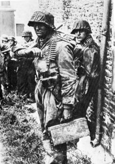 """Ww2 • Heavily Armed Youths of the 12th SS Panzer (Hitler Jugend) Division ready themselves for battle. The division, which consisted mainly of teenage volunteers, was created in June of 1943 and had its baptism of fire in Normandy a year later. - """"The young S.S. troops were detestable young beasts,"""" a British officer recalled, """"but, like good infantry, they stood up and fought it out when overrun."""" - In the fighting that raged around Caen, nearly 90 % were killed, wounded or captured"""