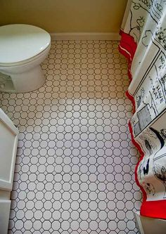 """We put simple white octagon-and-dot ceramic floor tile (American Olean, as I recall) from Lowes or Home Depot into Mom's second, small bathroom. It was really inexpensive -- and makes a big difference in terms of reading """"quality""""."""