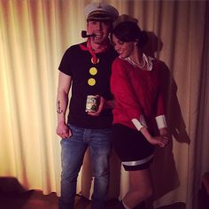 Popeye and Olive Oyl, but way cuter. you've already got the muscles!!!