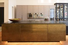 Urbo island in Antique Brass Metal wrap and worktop in African Fusion Quartzite