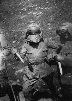 "occidental-martyr: "" Arditi wearing the Adrian helmet with Dunand visor. """