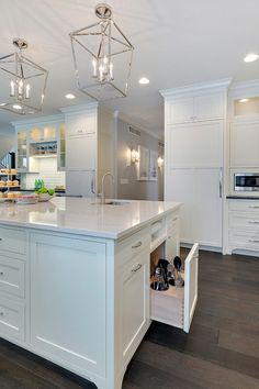 Kitchen island space saver photos and ideas. How to design an kitchen island space saver. This kitchen island has many inspiring space saver ideas! I love the paper towel holder and the cooking utensil drawer. Isn't this brilliant? #kitchenislandspacesaver Grace Hill Design