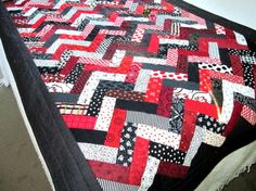 This dramatic red, white and black bed runner will keep your feet warm on a cold winter's night.