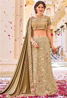 Indian Women fashion presents this golden color two-tone lycra pattern with glitter and lehenga style net with heavy work and lycra pattern party wear saree. Ideal for party, festive & social gatherings. This gorgeous saree featuring a beautiful mix of d Pakistani Bridal Dresses, Bridal Lehenga, Saree Wedding, Wedding Wear, Lehenga Style Saree, Party Wear Lehenga, Net Lehenga, Silk Sarees, Indian Designer Sarees