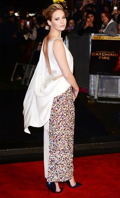 Jennifer Lawrence wears a backless Christian Dior dress with sequins and dark blue pumps