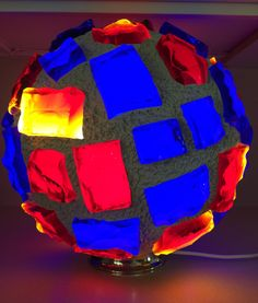 Fire and Ice - Chunk Glass Mosaic Lamp - 14 inch diameter Sphere weighing about 35 pounds. This beautiful illuminated sculpture is hand made by California artist Troy Boepple. The glass chunks are individually cut from 12 inch by 8 inch by 1 inch thick slabs of glass also know as Dalle de Verre. The glass slabs used in these creations are from an art glass manufacturer that has been in business since 1898 and was one of the original suppliers for Tiffany's. Each of the glass chunks are hand…