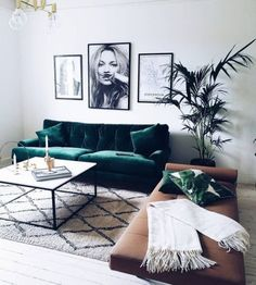 VELVET CRUSH. Green velvet sofa with a brown leather bench pop in this grey scale living room.