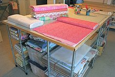 DIY cutting table with metal shelving from IKEA--I used this idea for my big basting table--it's wonderful