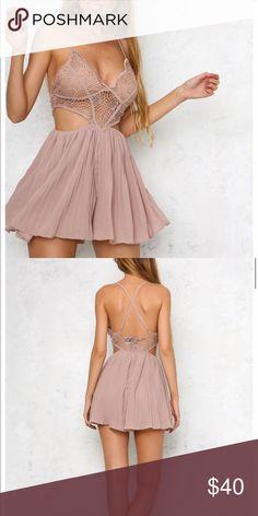 NWOT Playsuit NWOT. Perfect condition.  Bought online on an Australian boutique website.  Australian size 10.  US size 8 (medium). Dresses