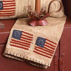 I would love to make a couple of these to use as drapes for my stove handle.  Very Americana.