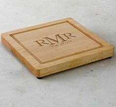 Crafted from premium-quality maple wood, our handsome cutting board can be personalized with a stylized three-letter monogram and custom year. Use it as a cutting surface or a serving tray or simply display it as a family keepsake.