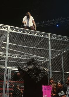 Mick Foley, as Mankind, faced The Undertaker in one of the most legendary Hell in a Cell matches at the Pittsburgh Civic Arena in Long Island native Foley's fall from the cell onto the Spanish announce table is one of the most memorable mome Wrestling Memes, Watch Wrestling, Wrestling Stars, Wrestling Superstars, Wrestling Divas, Wwe Entertainment, The Wyatt Family, Wrestlemania 29, Undertaker Wwe