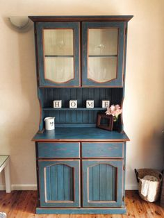 Old pine display cabinet re-vamped using Annie sloan chalk paint in Aubusson blue.
