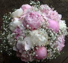 Delicate pale pink and white peony with hydrangea and gypsophilla. British flowers at their best. Created by gailarmytage of Cowbridge , Wales .