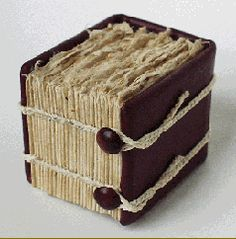 Untitled, 2002 - designed and hand-crafted by Roberta Lavadour. «This one-of-a-kind book was part of an exploration into different board attachments for chain stitched books. I call this a reverse block binding. Handmade paper crafted from wheat stalk from the field next to the old studio, cover of reclaimed jacket leather, end sheet pulp-painted handmade paper.»
