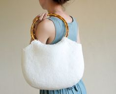 A personal favorite from my Etsy shop https://www.etsy.com/listing/156778481/white-shoulder-bag-with-bamboo-grips