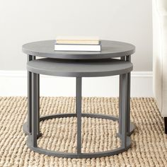 Make the most of your available space with these contemporary nesting tables from Safavieh. The smaller of these two charcoal-gray tables fits underneath the larger one, so it can be easily pulled out when extra surface area is needed.