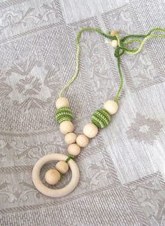 Nursing necklace with ring teething necklace by NatkaLV on Etsy, $11.99