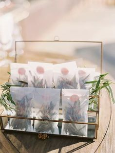 Rosemary wedding favor packets for guests. The couple tied the knot at Cordiano Winery in Escondido, California, and celebrated with a Tuscan + Italy-inspired microwedding complete with pizza, Champagne and olive oil favors for guests.