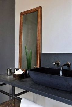 minimalist black bathroom w/ leaning wood mirror.i would need another mirror but love this Home Interior, Bathroom Interior, Modern Bathroom, Interior And Exterior, Minimalist Bathroom, Design Bathroom, Modern Interior, Stone Bathroom, Bathroom Black