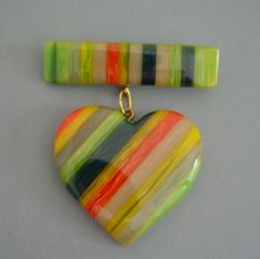SHULTZ bakelite green and multi-color rows heart brooch from Morning Glory Jewelry. Buy now for $225.00