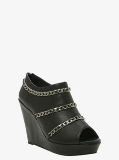 Add some sexy length to your look with these sleek black faux leather wedge booties that feature a peep toe and three hematite tone chains wrapped around the top of them. Back zip entry.