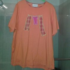 I just added this to my closet on Poshmark: Susan Grover/Style Orange tee w/embroidered pics. Price: $24 Size: 1X
