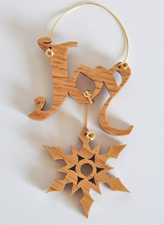New Lower Price! Hang your wishes on your Christmas tree, or anywhere else! The word Joy and a snowflake, hand cut using a scroll saw from quarter-inch red oak, and beautifully finished with shellac, then joined together and hung with 20-gauge wire. Great for any decor - in any season. Measures 3 inches wide by 3.5 inches high (plus the hanger). Check out all of our inspirational words: Hope: https://www.etsy.com/listing/107855072/hope-christmas-ornament-inspirational Celeb...