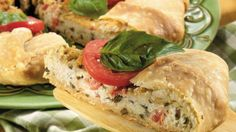 Italian Appetizer Wedges:  1box Pillsbury® refrigerated pie crusts, softened as directed on box.  1/2cup Progresso® Italian-style bread crumbs.  1/3cup chopped fresh basil.  1/4cup grated Romano cheese.  1/4teaspoon salt.  1/4teaspoon freshly ground pepper.  1cup part-skim ricotta cheese.  3tablespoons extra-virgin or regular olive oil.  3plum (Roma) tomatoes, seeded, diced.