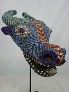 Africa   'Buffalo' mask from the Bamileke people of the Grassfields, Cameroon   mid 20th century   Wood, fabric and glass beads